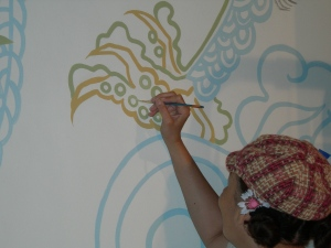 Pamela Starks adds to the mural