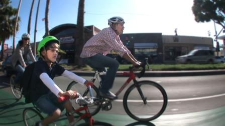 A family rides on the Sharrows in Long Beach