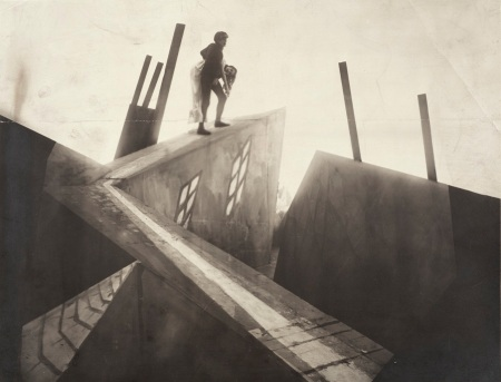 Unknown German Artist, Untitled (Cesare [Conrad Veidt] Carrying Jane [Lil Dagover] across Rooftops), 1919, set photograph from the film Das Cabinet des Dr. Caligari (The Cabinet of Dr. Caligari), The Robert Gore Rifkind Center for German Expressionist Studies