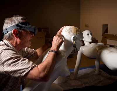 A member of the LACMA conservation team readies a mannequin for display. Reproduction Korova Milk Bar Mannequin, A Clockwork Orange, c. 2003, Replica: Cornelius Korff Breymann, Mutterschied, Wigs: Katy McClintock, Frankfurt am Main, Deutsches Filmmuseum, Frankfurt am Main, photo © 2012 Museum Associates/LACMA