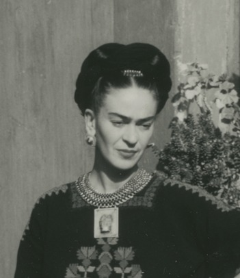 Photo by Florence Arquin of Frida Kahlo in Coyoacán, wearing a necklace made for her by Frederick Davis with a Tlatilco ceramic figure on a silver plaque (detail), 1949, photo: courtesy of Spencer Throckmorton, New York