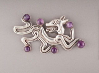 "William Spratling, ""Jaguar Brooch,"" c. 1940–46, silver and amethyst, gift of the Goddard Family in memory of Phyllis Goddard, Los Angeles"