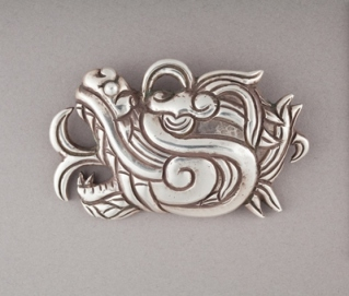 "William Spratling, ""Quetzalcóatl Head Brooch,"" 1938–44, silver, gift of Ronald A. Belkin, Long Beach, California"