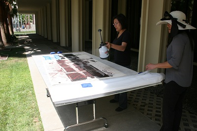 Associate Conservator, Soko Furuhata, humidifying the print with a Dahlia sprayer.