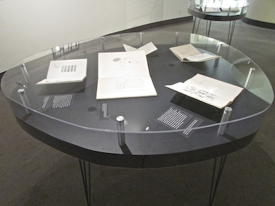 Oval tables custom made for the exhibition were inspired by Kitasono's aesthetic.
