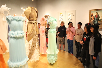 Students discuss the Rodarte gowns, making connections to the adjacent Italian Renaissance paintings.