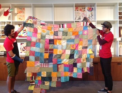 The patchwork textile reflects the diversity of visitors to the Boone Children's Gallery.