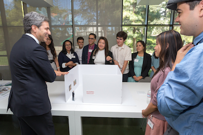 LACMA director and Wallis Annenberg CEO Michael Govan with the Andrew W. Mellon Summer Academy participants and their exhibition model. Photo © Museum Associates/ LACMA