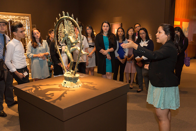 The Andrew W. Mellon Summer Academy participant, Liliana Sanchez, presenting the sculpture, Shiva as the Lord of Dance to the rest of the group. Photo © Museum Associates/LACMA